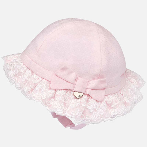Formal hat with lace ruffles and bow