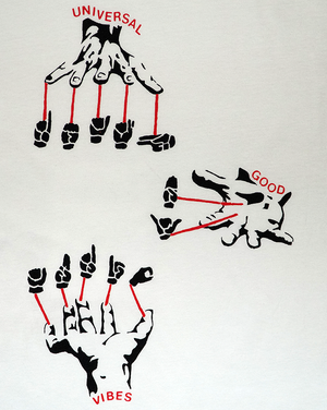 Close-up of graphics of sign language hands signing Death By Audio with text Universal Good Vibes.