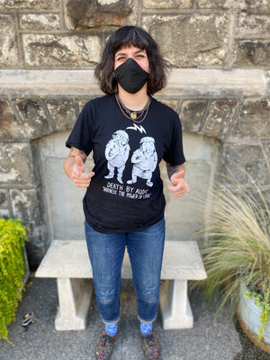 Marissa Paternoster models the t-shirt she designed for Death By Audio