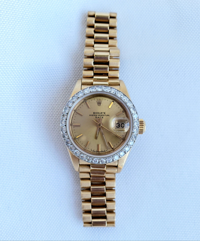 Rolex Ladies 18kt Yellow Gold with Diamond Bezel, 26mm
