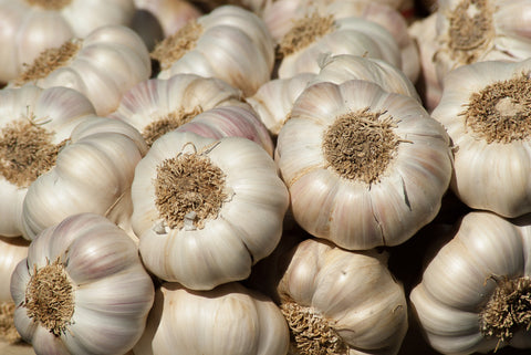 many bulbs of garlic piled atop one another