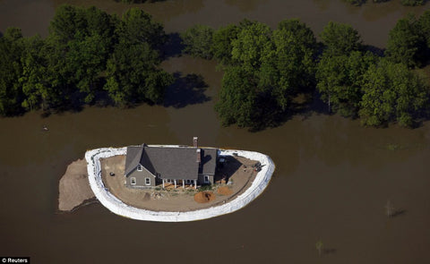 Wise homeowner protects home with sandbags barrier