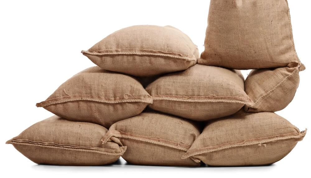 Filled burlap bags stacked on top of each other