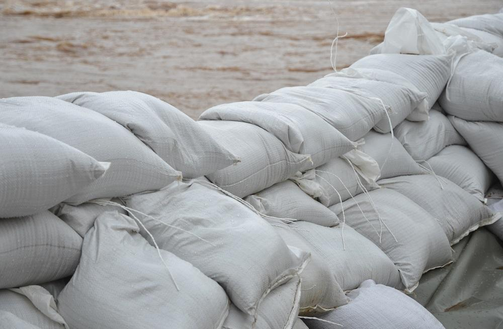 Poly sandbags used to construct a sandbag wall to protect against flooding
