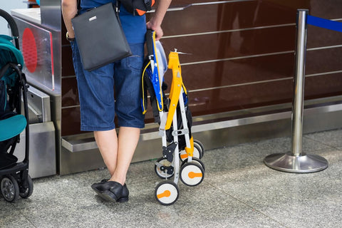 Traveling Soon? Stroller at airport check-in counter