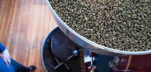 Unroasted coffee beans in roaster