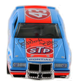 "Richard ""The King"" Petty's #43 STP / 200th Win 1984 Grand Prix diecast. Autographed."