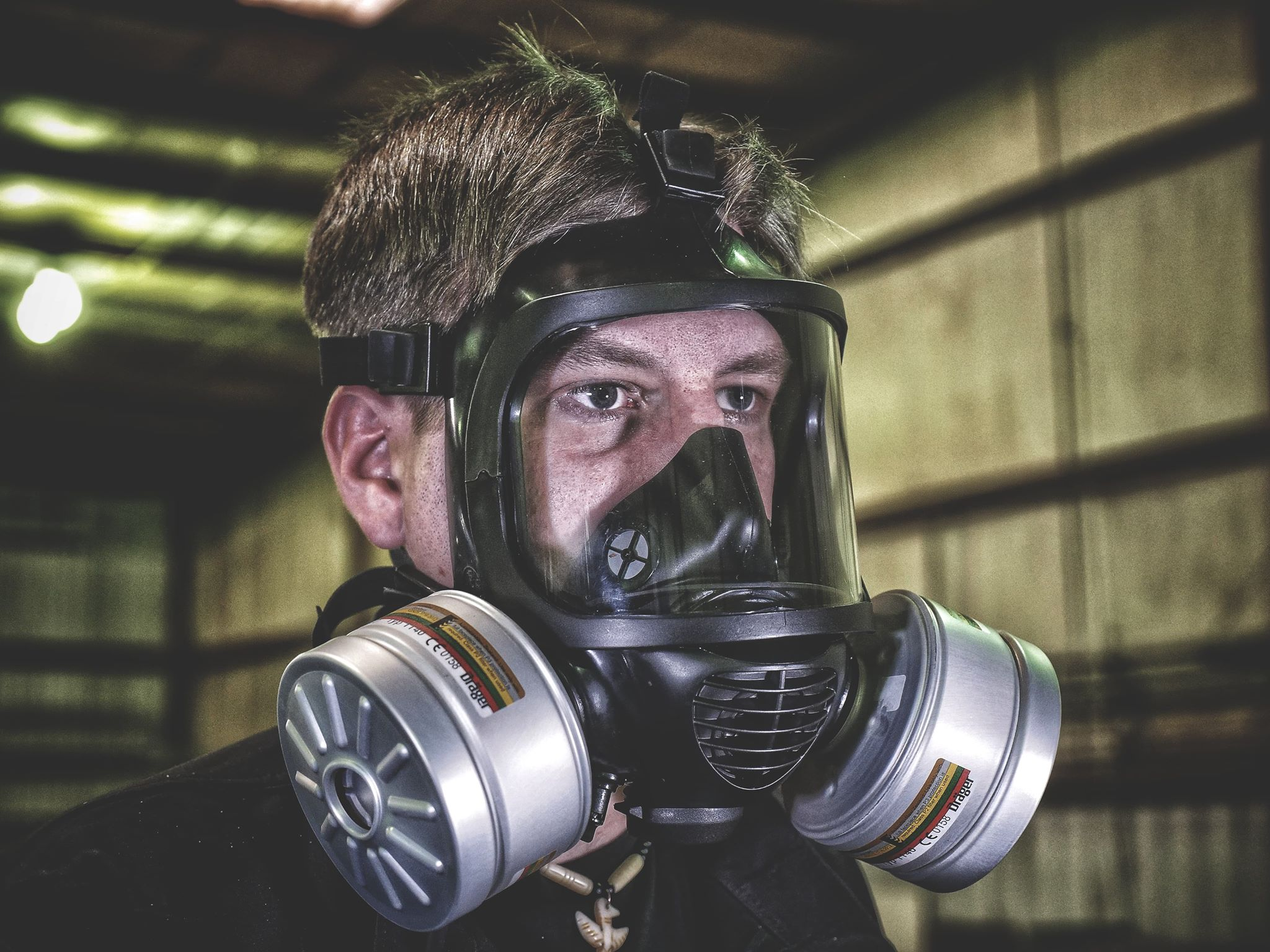 Side view of a man wearing the CM-6M tactical gas mask
