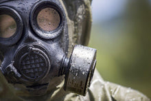 Military CBRN specialist with the NBC-77 SOF CBRN gas mask filter