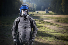 Man wearing riot gear and the MIRA Safety CM-6M riot control gas mask