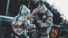 Father and child wearing full CBRN PPE