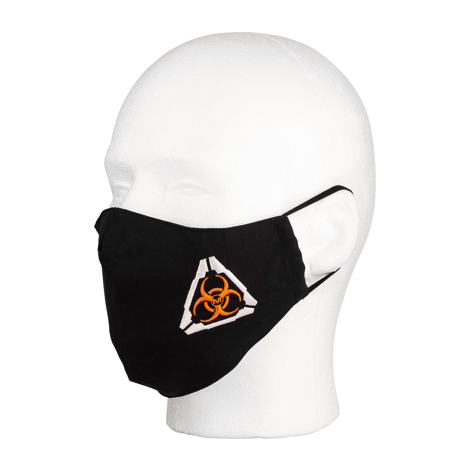 Three quarter view of the MIRA Safety Mask with biohazard insignia on a mannequin head