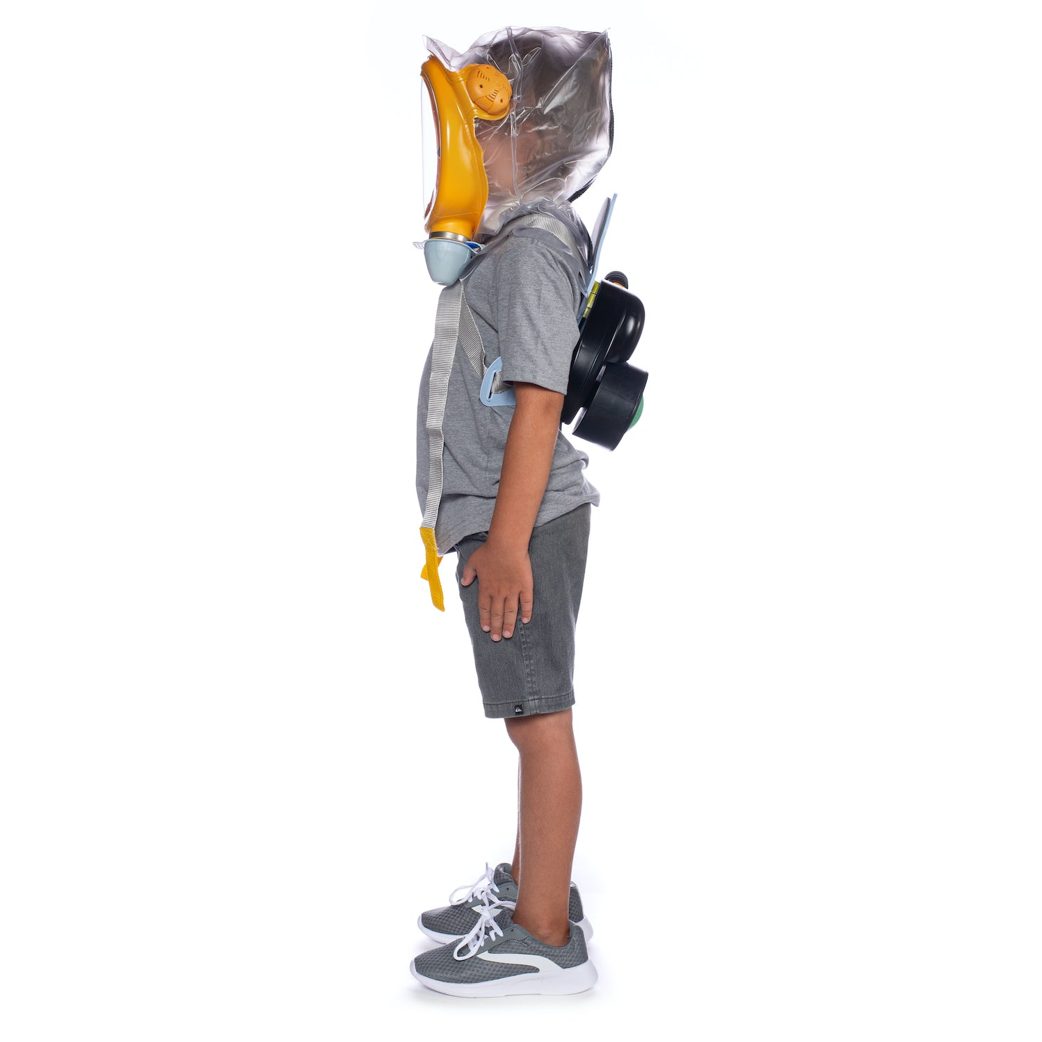 Child standing sideways while wearing the CM-3M Baby Gas Mask