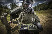 Solider testing air samples while wearing the CM-7M nuclear gas mask