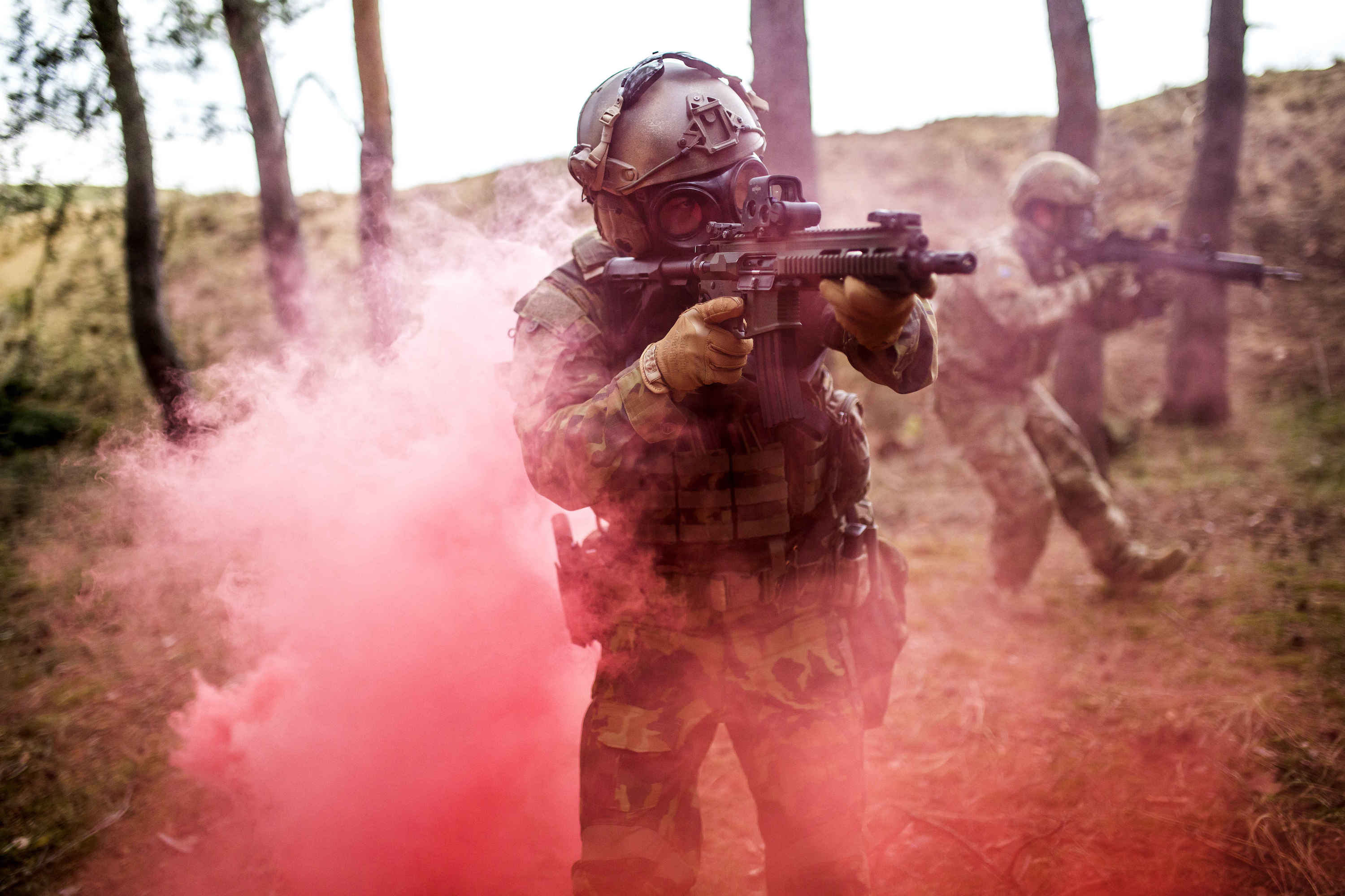 Soldier going through dense smoke while wearing the CM-7M military grade gas mask