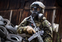 Soldier with full military wearing wearing the CM-7M NATO gas mask