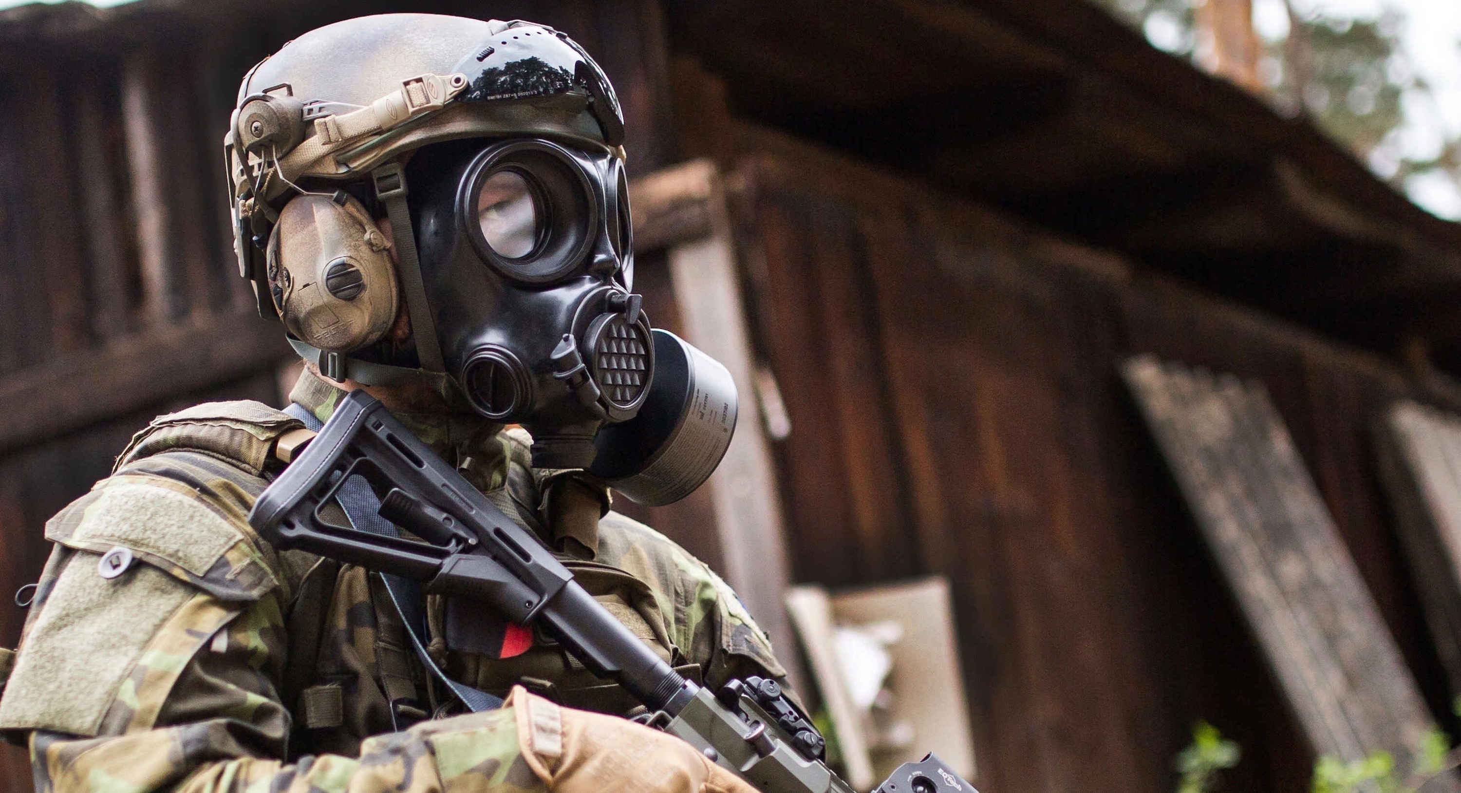 Solider standing sideways while wearing the CM-7M military gas mask
