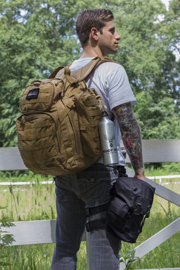 Man wearing a backpack, along with the MIRA Safety Nuclear Survival Kit