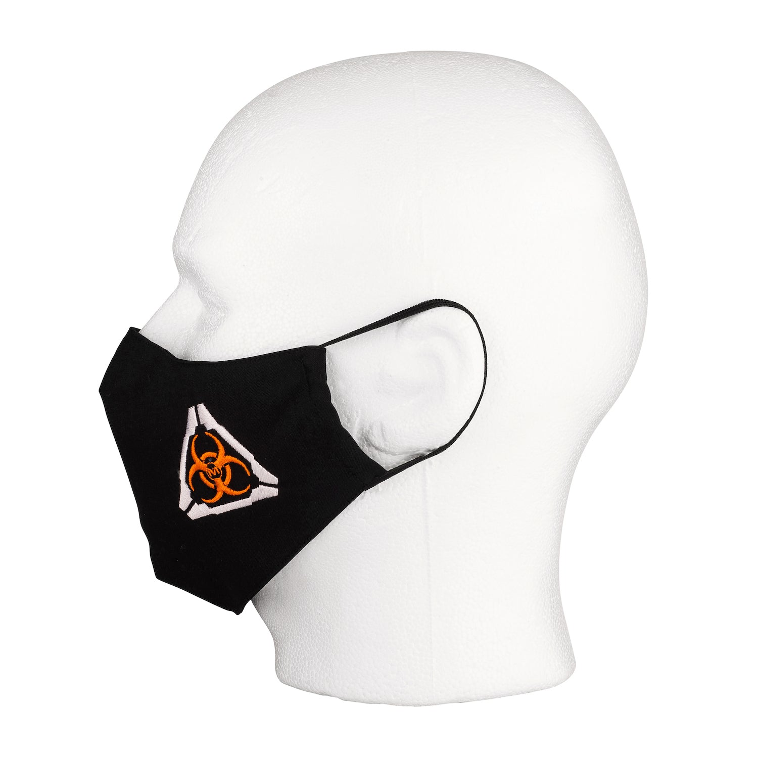 Side view of the MIRA Safety Mask with biohazard insignia on a mannequin head