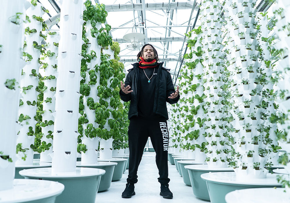 Zion I Baba Zumbi at Altius Greenhouse in Colorado rocking hemp clothing for DJ Cavem's Sprout That Life music video