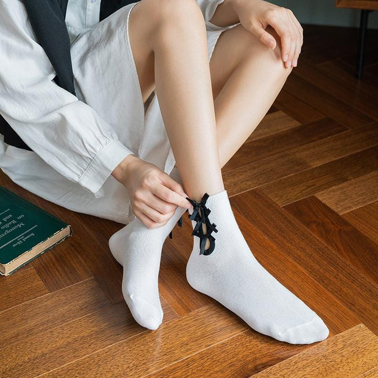 Pile socks with bow knot