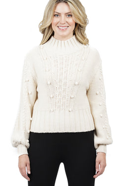 Annalise Cable Sweater with Pom Sleeves.