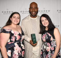 Karamo Brown from Queer Eye holding a Kadee Botanicals Body Lotion