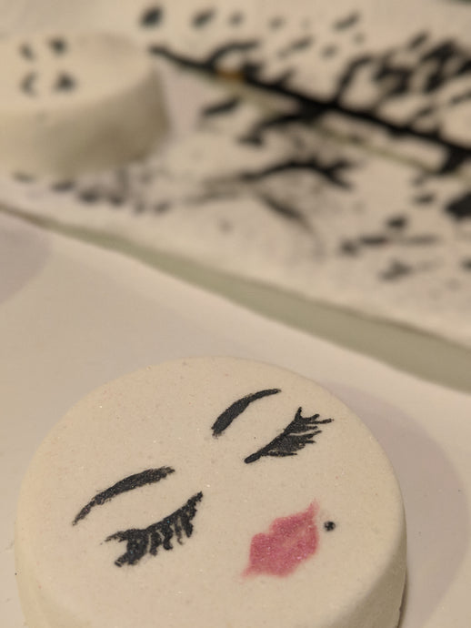 Hand painted pin up face bath bombs made in Vancouver, BC.