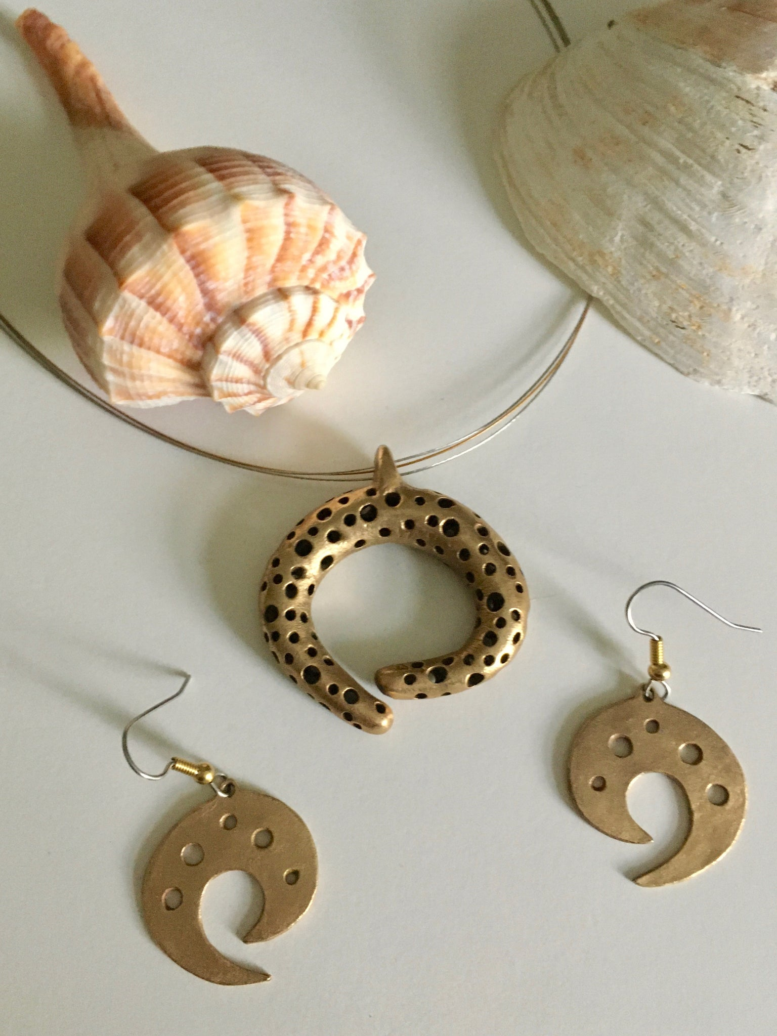 Perfect pairing of pendant and earrings