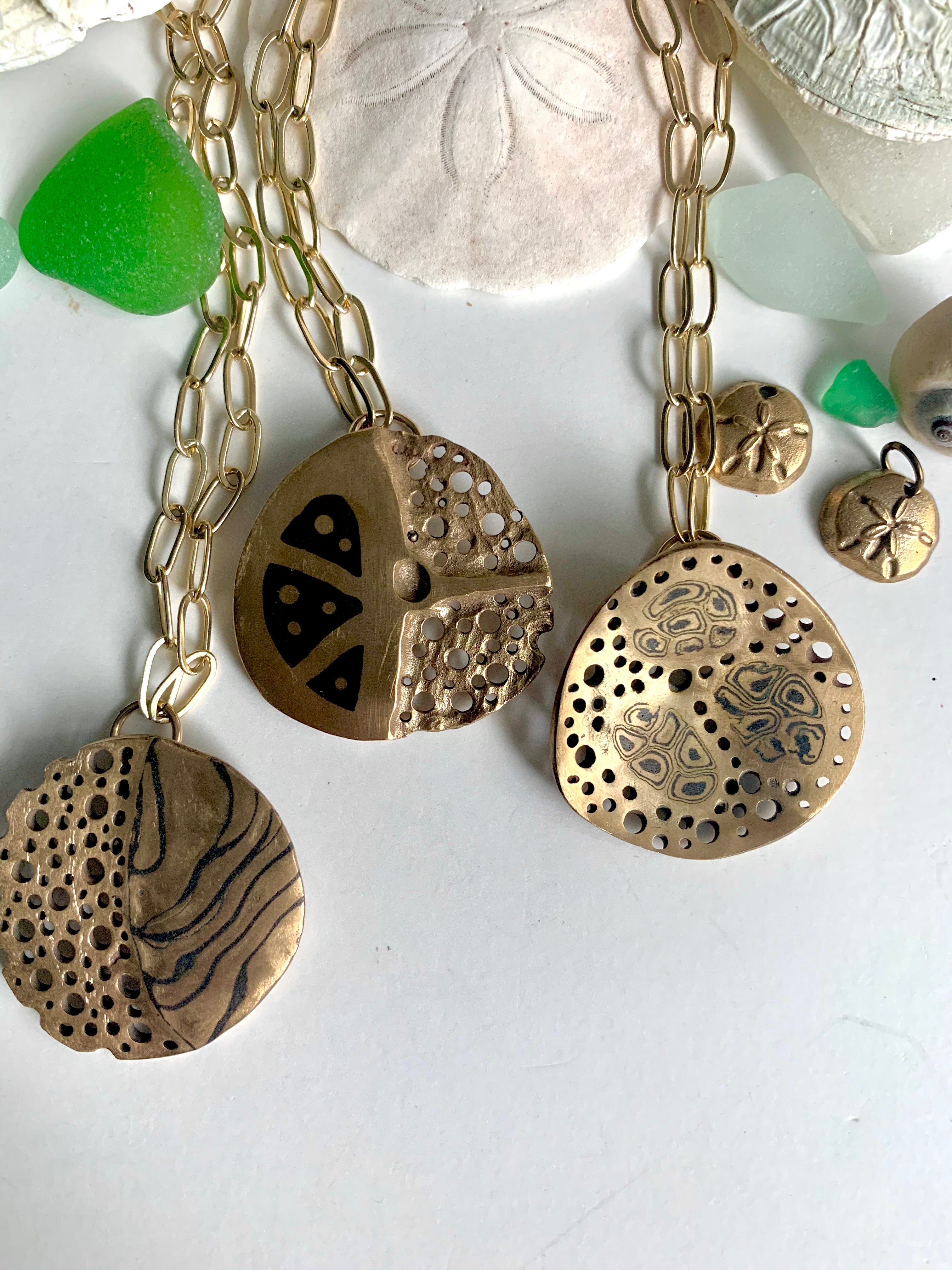 Sea shells with ocean inspired art jewelry necklaces
