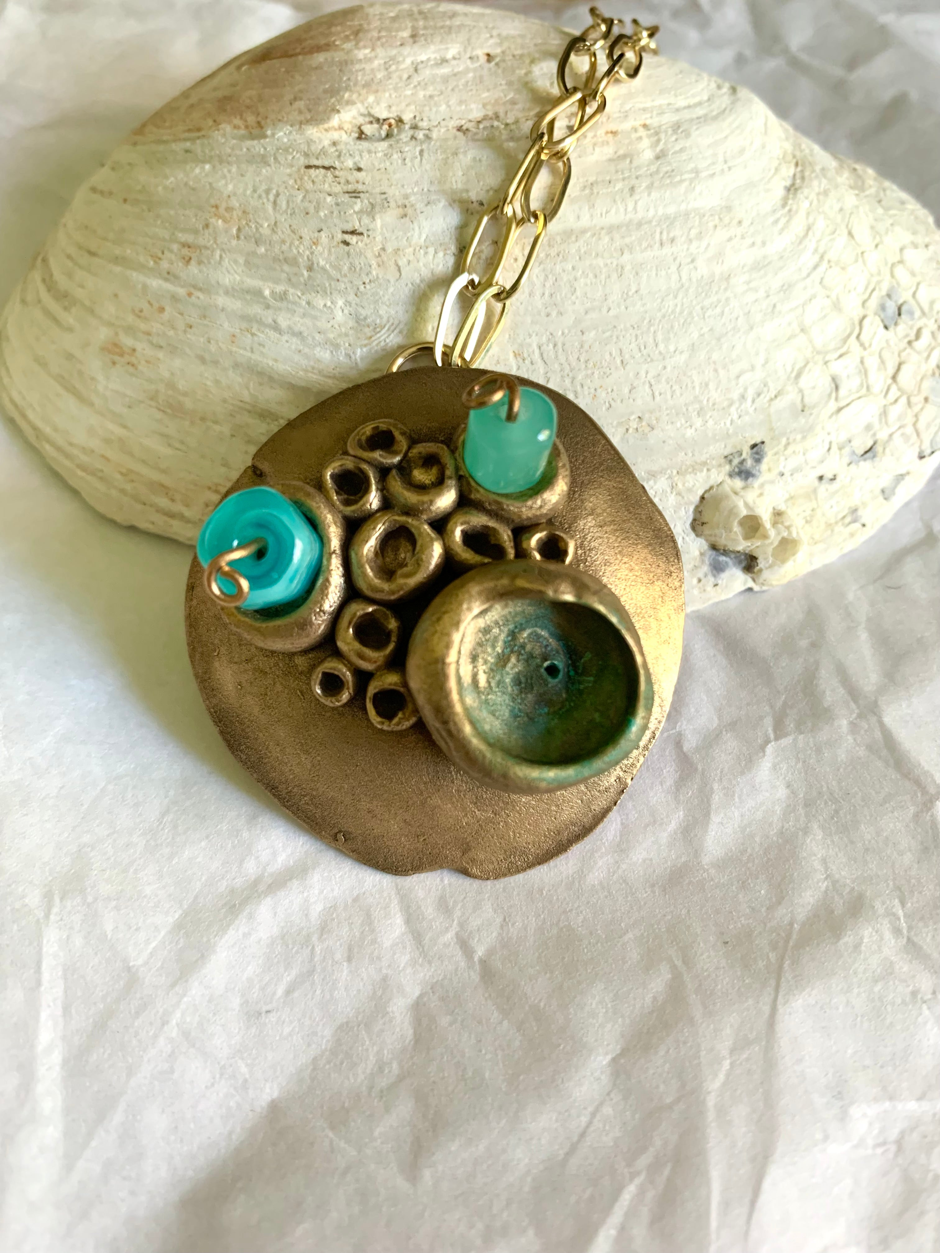 Ocean inspired statement necklace made from bronze and blue glass beads