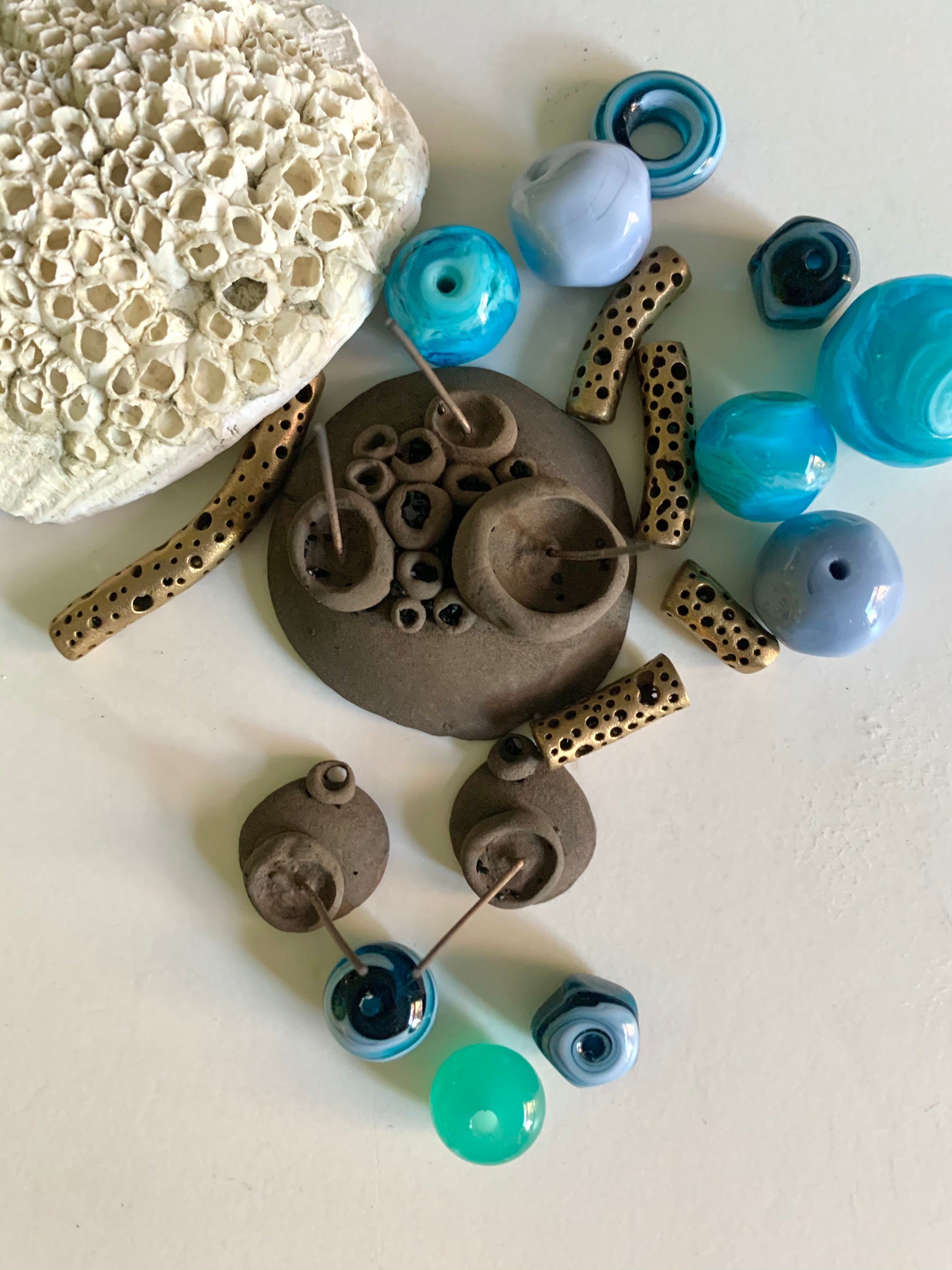 Artisan made ocean coloured glass beads with new bronze barnacle jewelry pieces