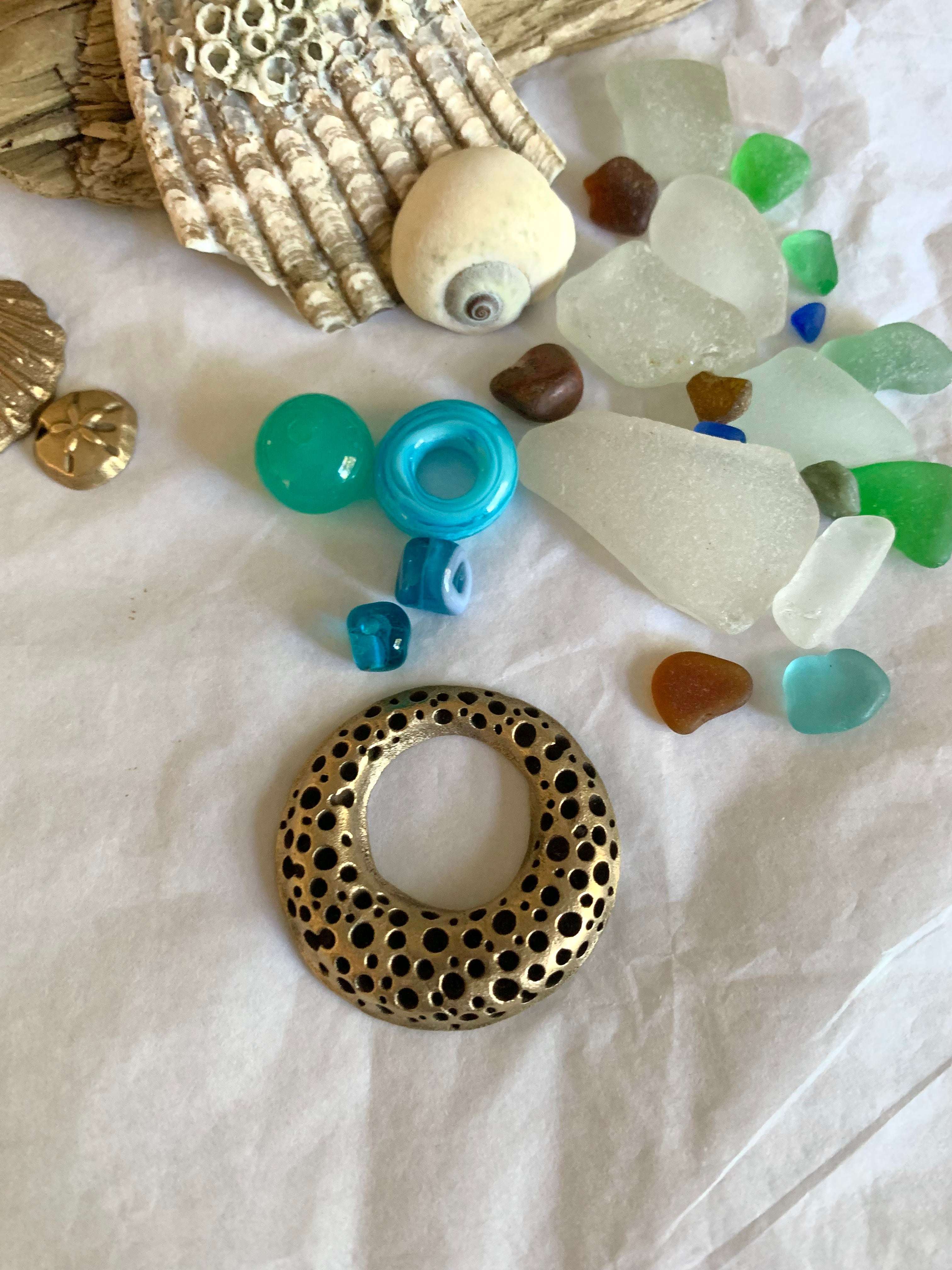 Sea glass with bronze ring and blue glass beads
