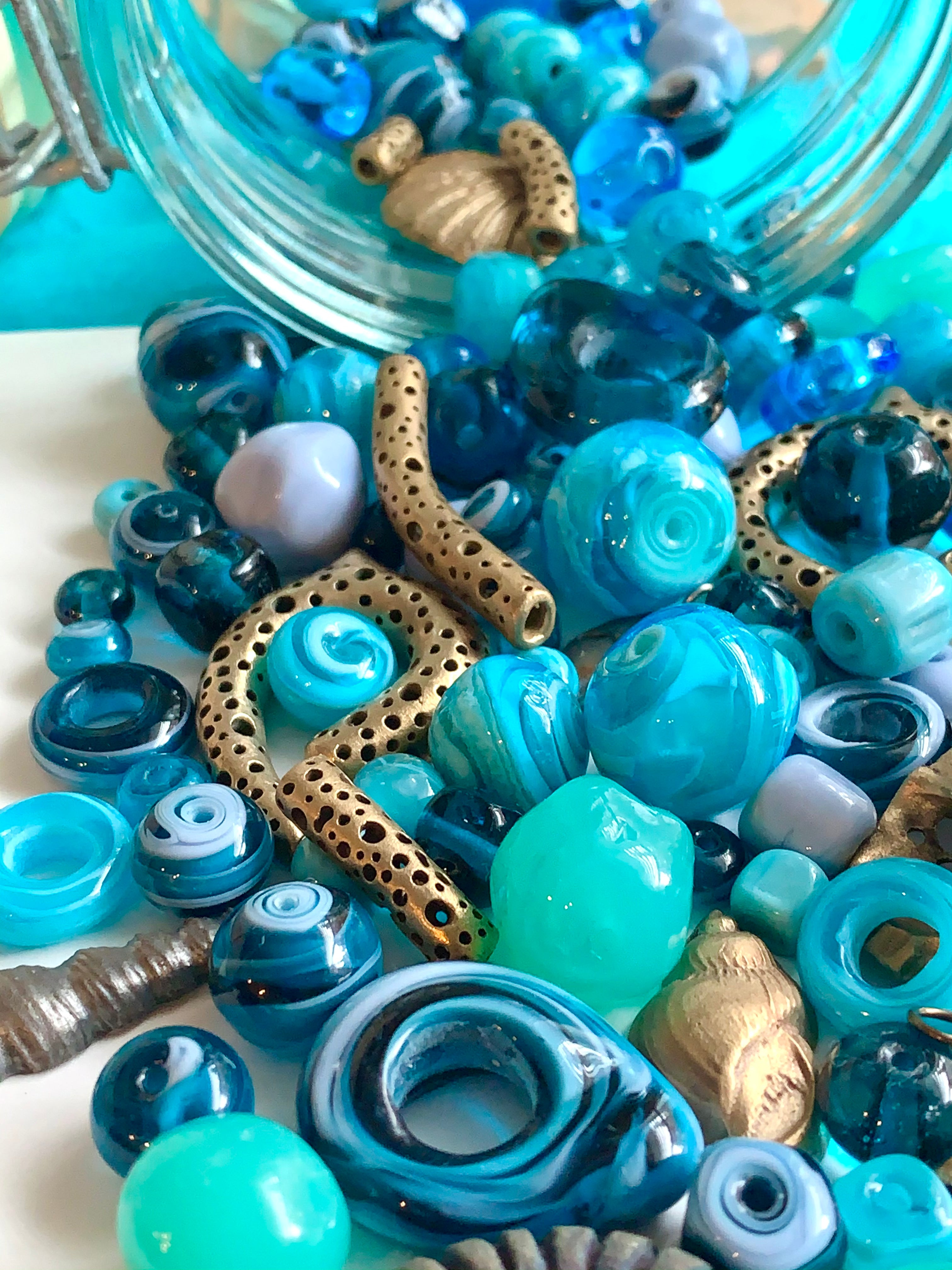 Art beads in bronze steel and blue glass
