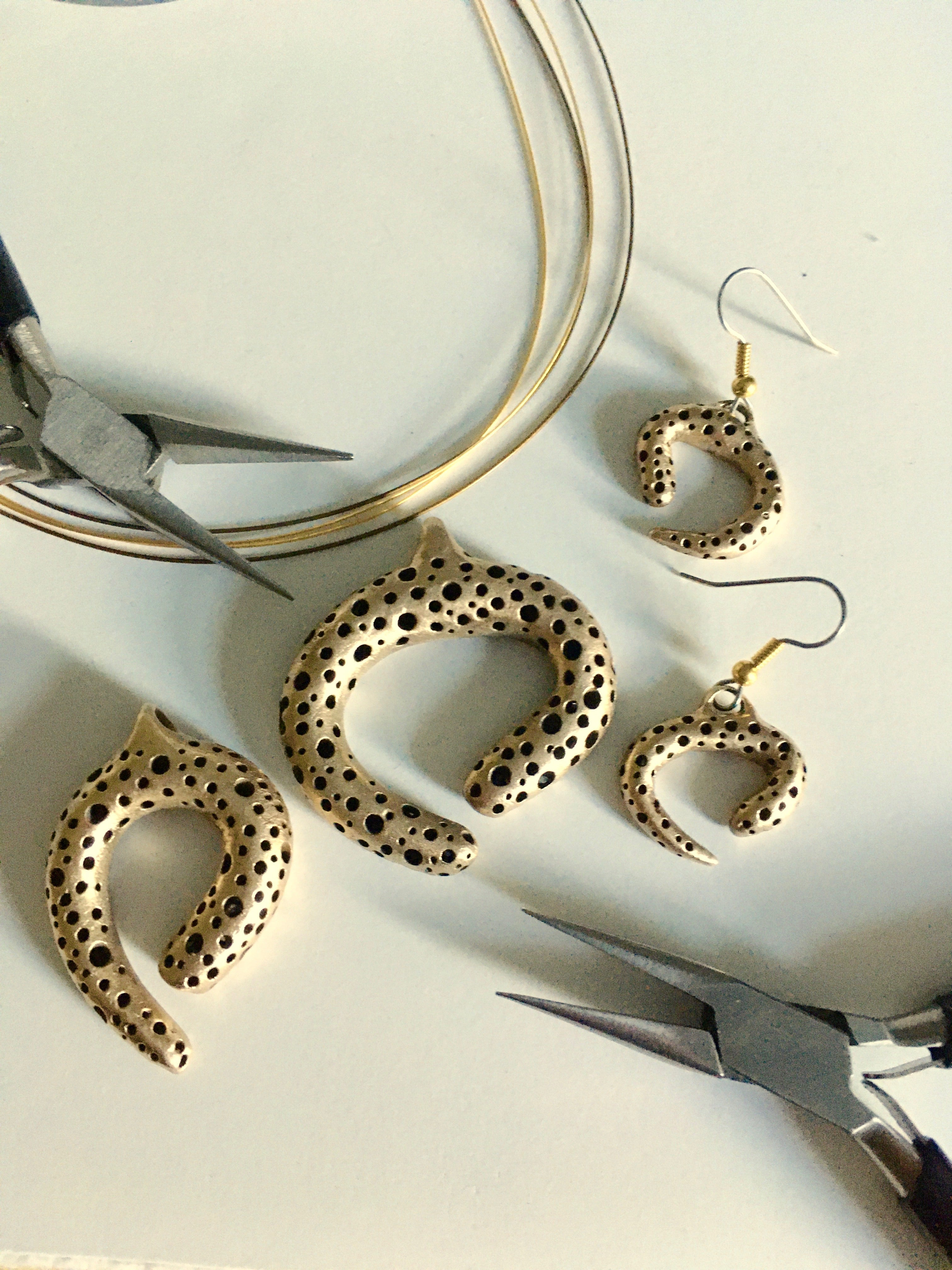 Bold hand carved bronze jewelry pieces