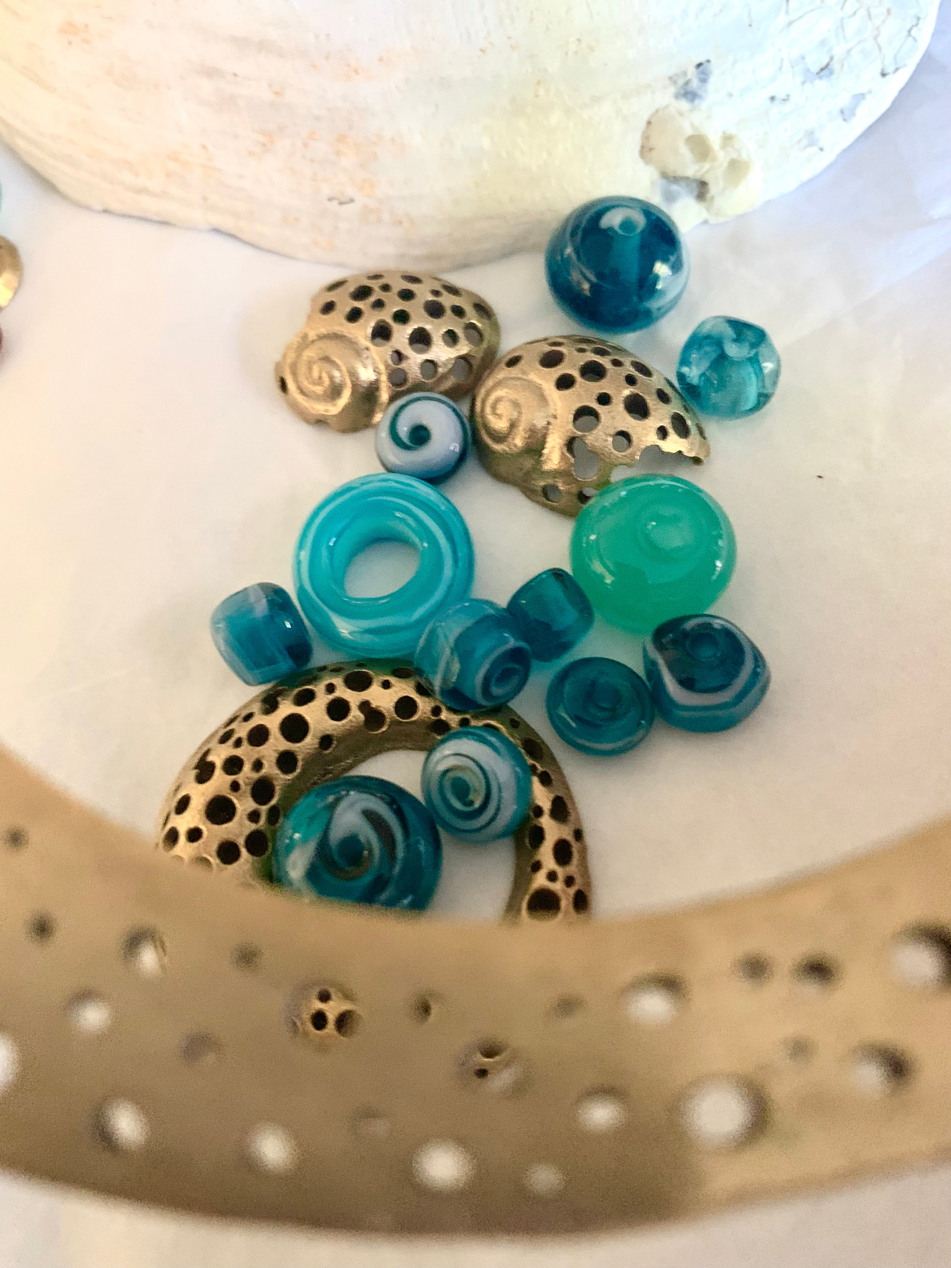 Bronze artisan made pieces with blue glass beads