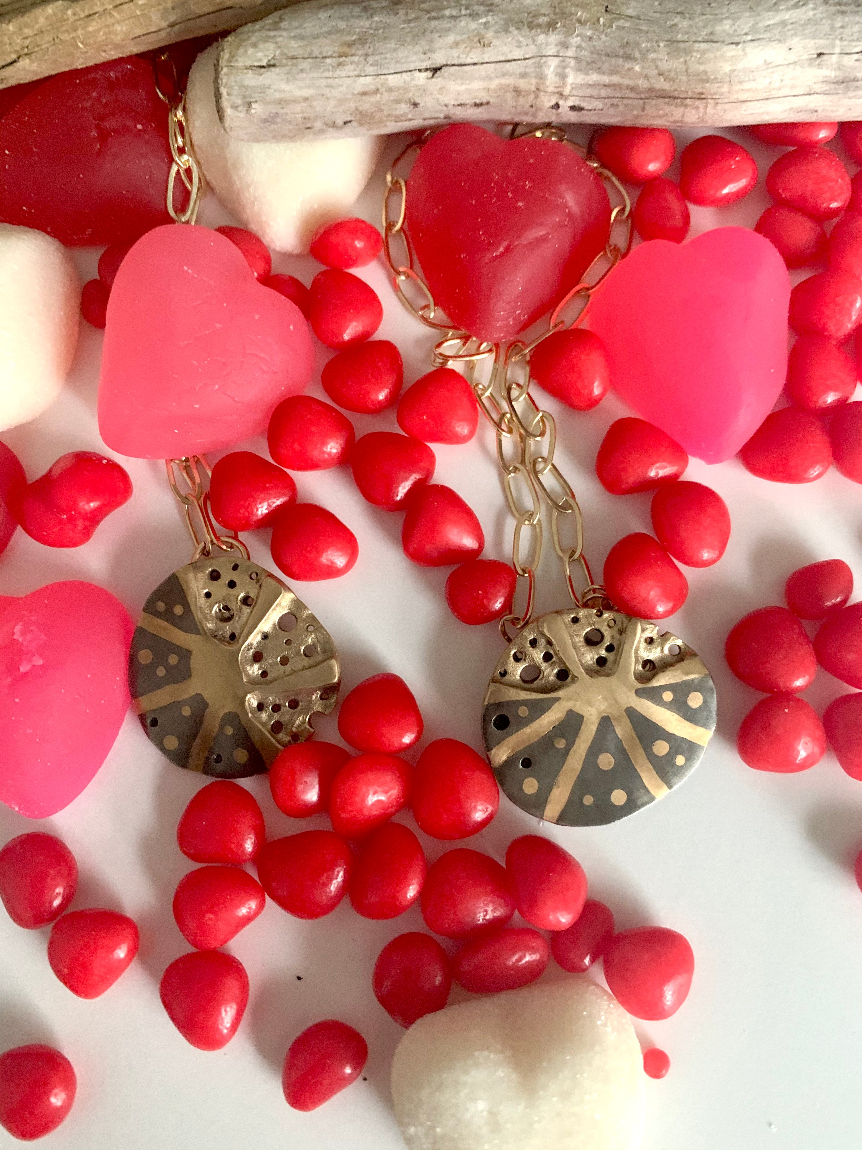 Bronze and steel necklaces with pink and red hearts