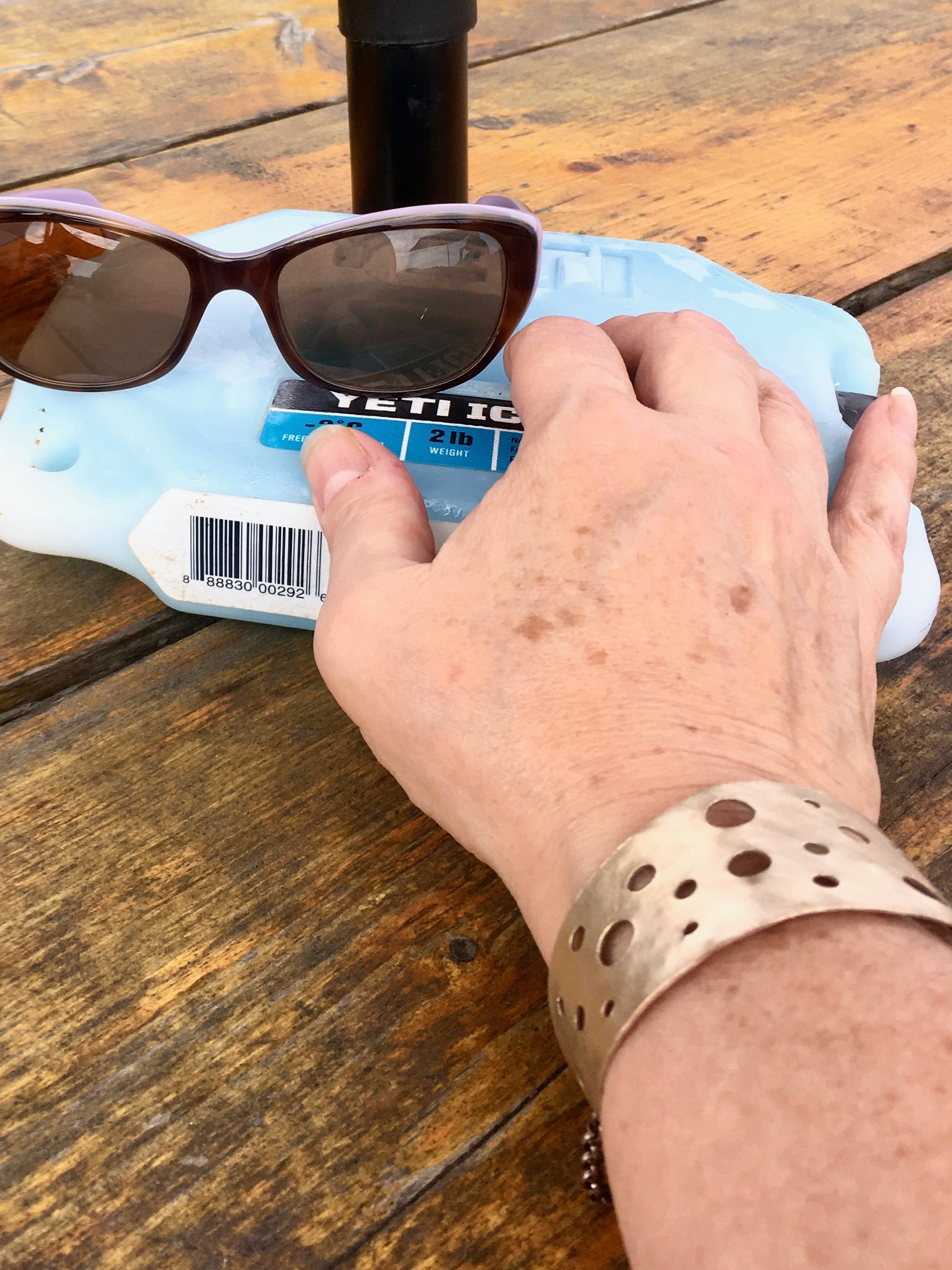 Bronze artisan made cuff with icepack and sunglasses
