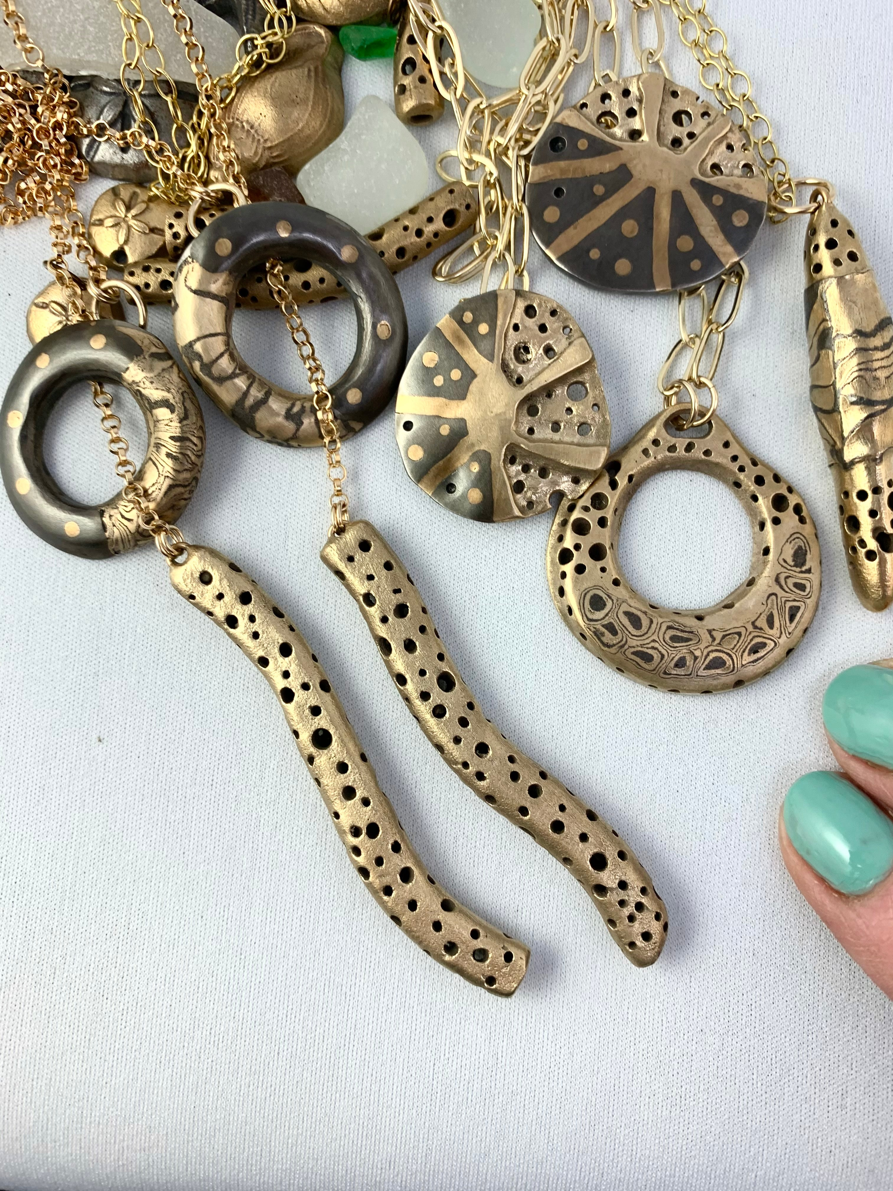 Artisan made bronze and steel new necklaces