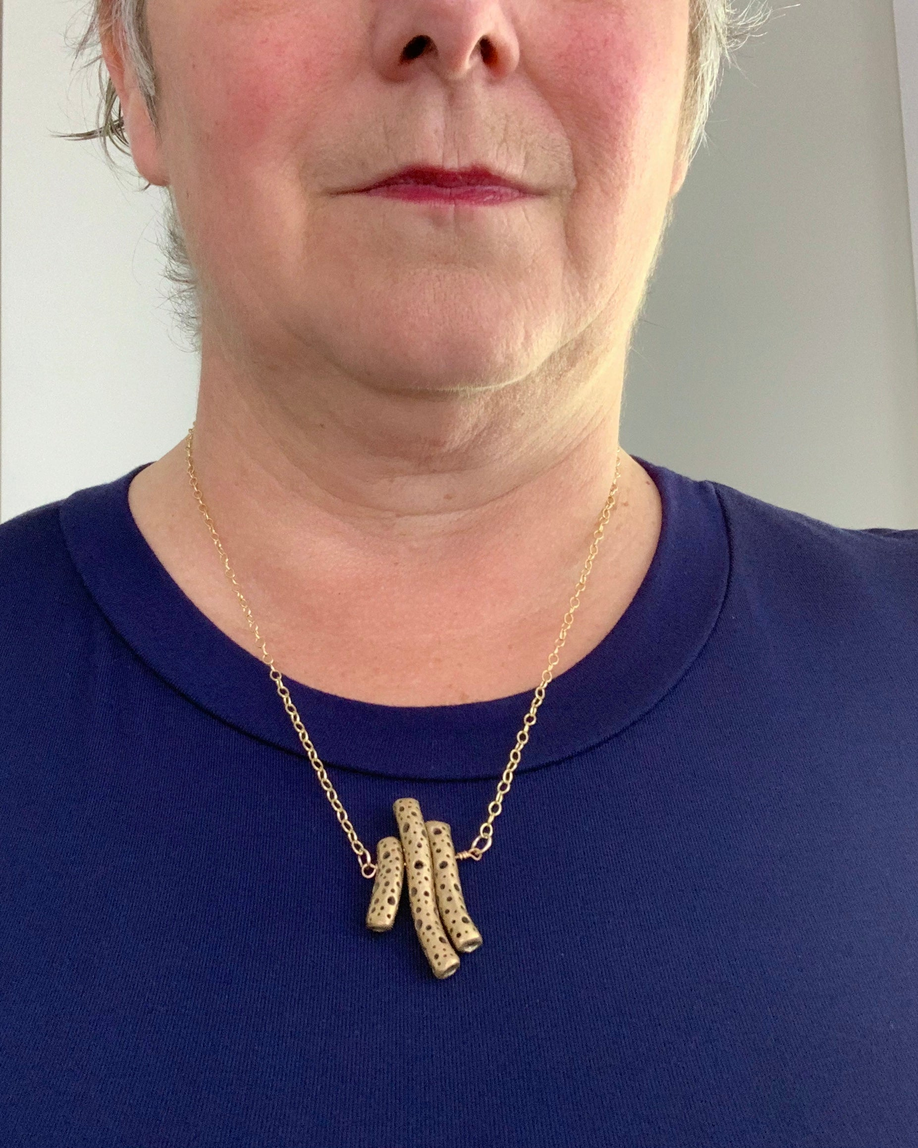 Royal blue shirt and bronze art jewelry necklace