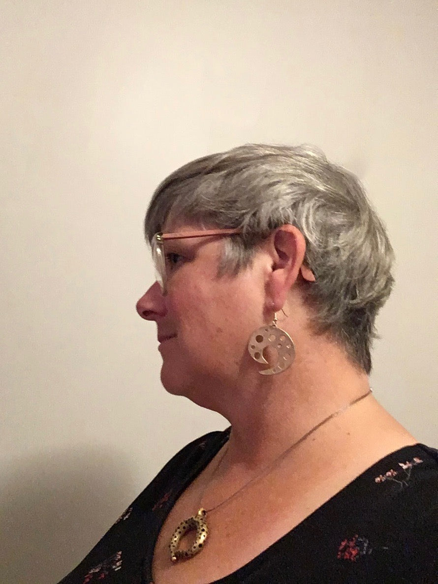 Bronze statement earrings short grey hair