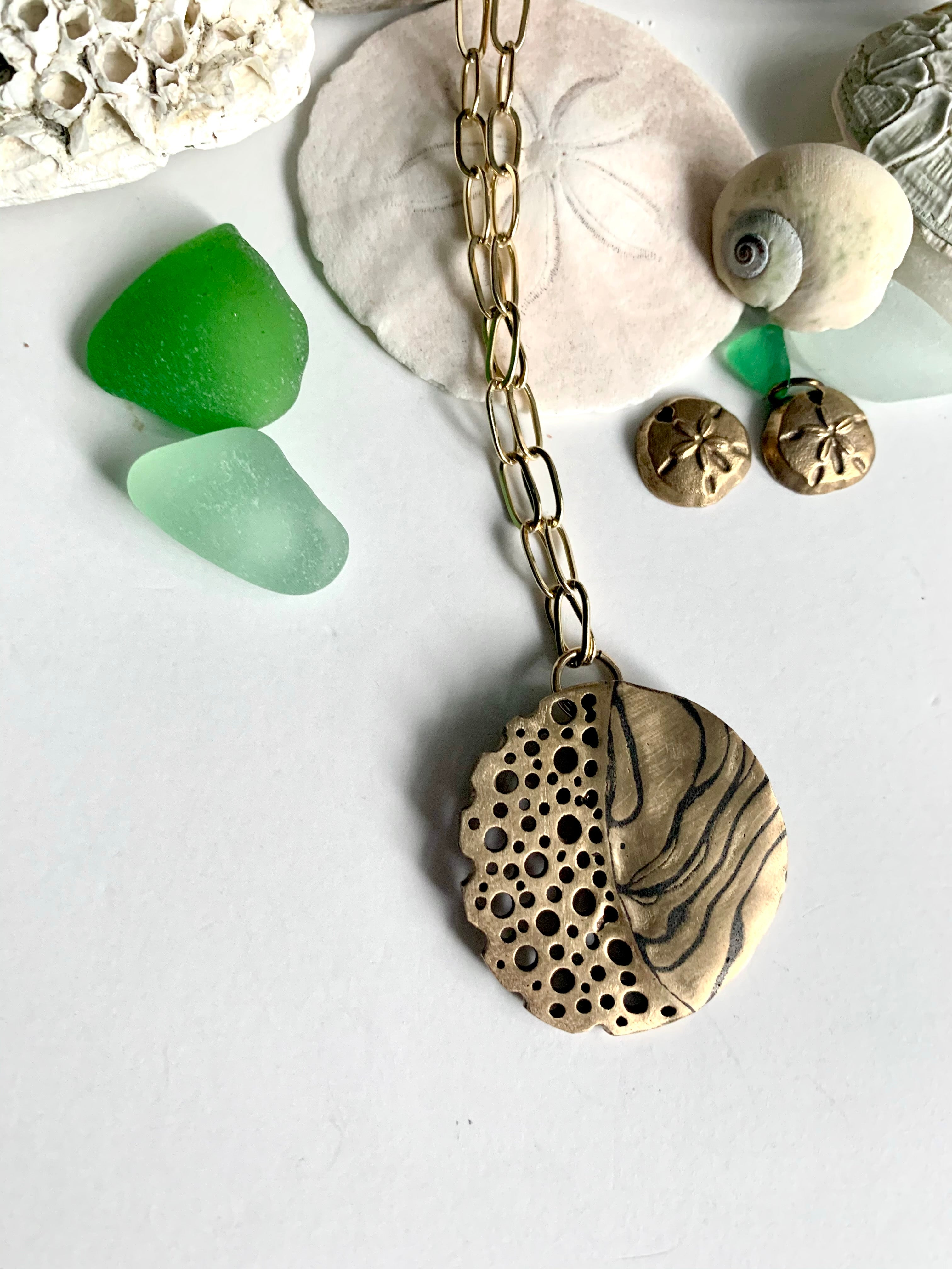 Ocean inspired hand crafted necklace with shells and green sea glass