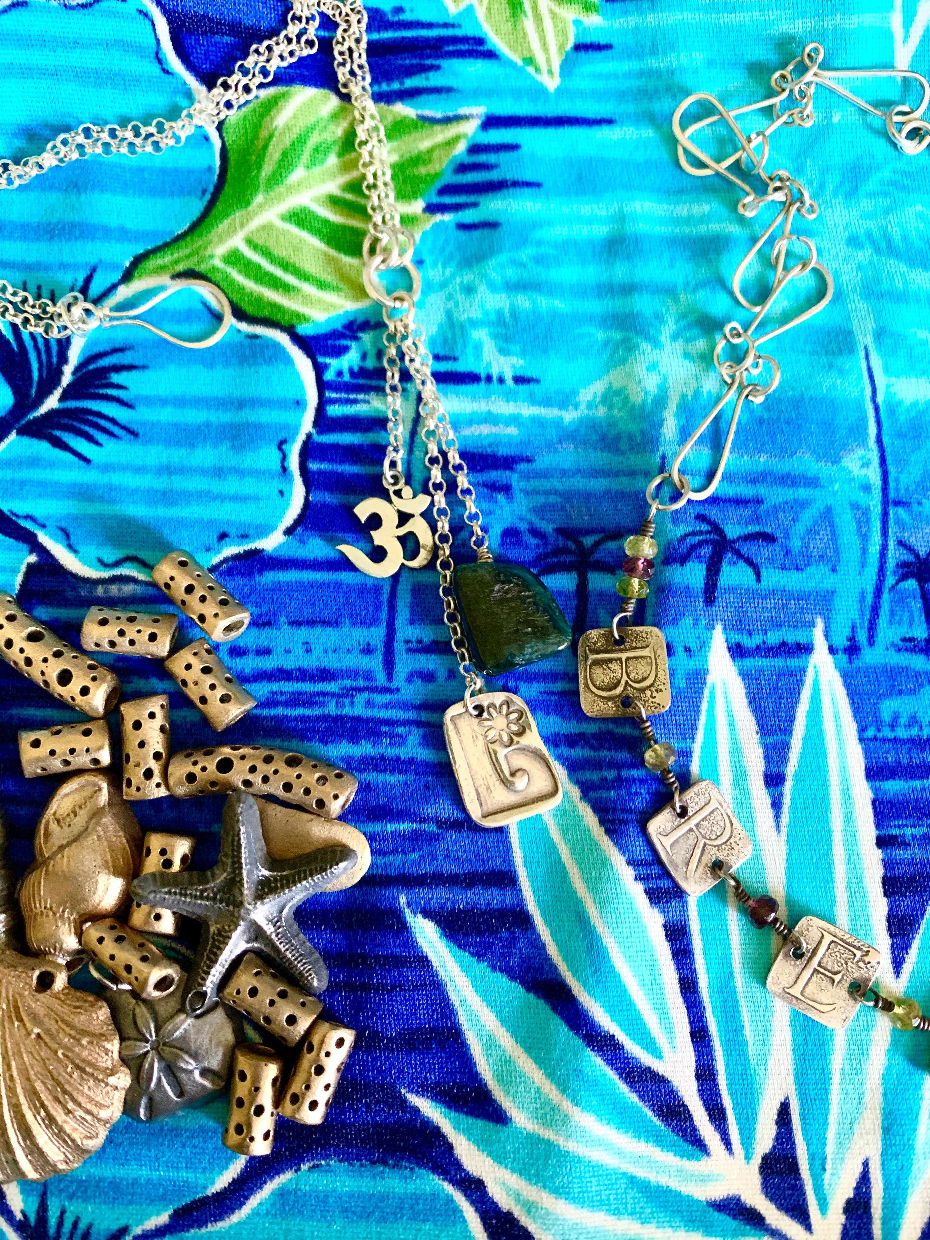 Bronze beads, tropical blues and yoga style necklaces