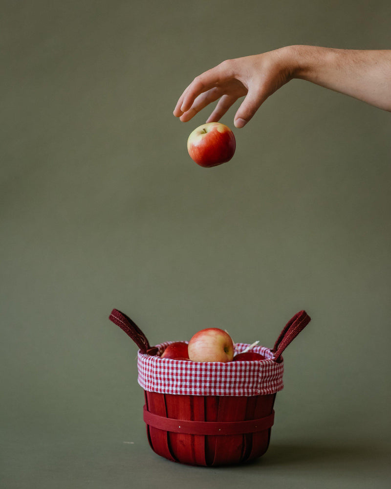 putting apples in a basket