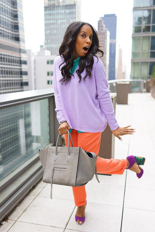 June Ambrose: Lilac over-Sized Sweater Paired  with Orange Trousers