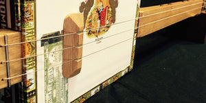 Looking for a basic cigar box guitar to get you started?