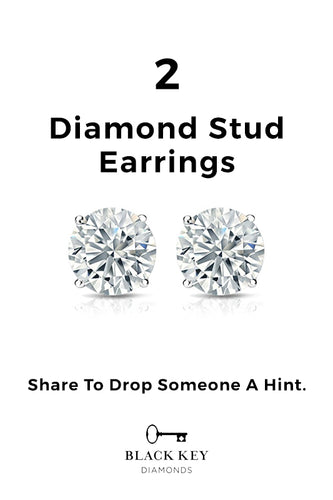 14. 2 x Diamond Stud Earrings