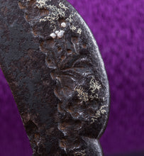 Iron Tanto Tsuba Decorated with Buddhist Temple Motivs