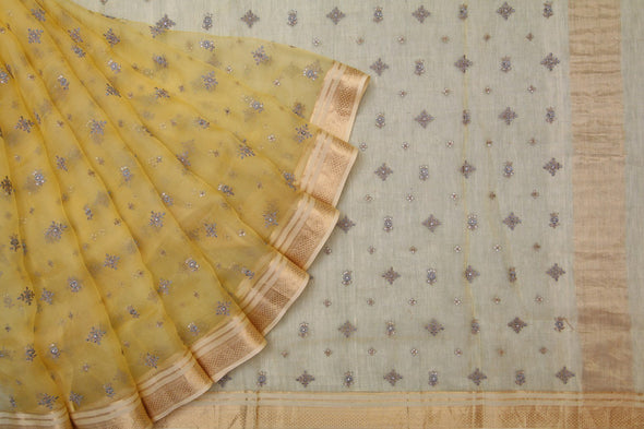 Pastel yellow organza embroidered saree