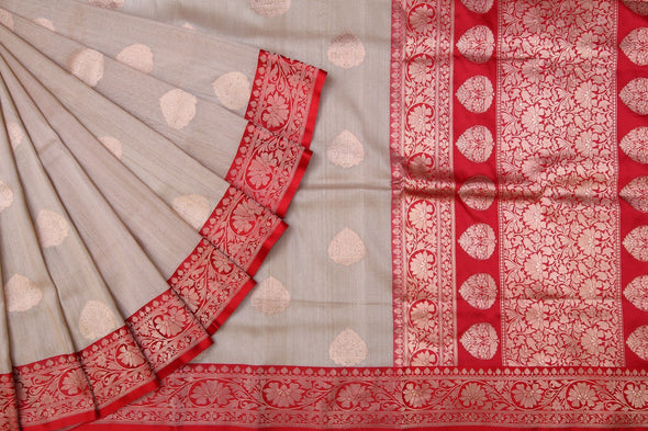 Cream Banarasi Tussar Silk Handloom saree with gold Leaf Buttas